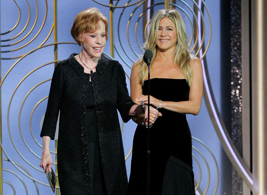 This image released by NBC shows presenters Carol Burnett, left, and Jennifer Aniston at the 75th Annual Golden Globe Awards in Beverly Hills, Calif., on Sunday, Jan. 7, 2018. (Paul Drinkwater/NBC via AP) / 2018 NBCUniversal Media, LLC