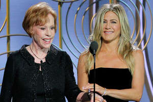 This image released by NBC shows presenters Carol Burnett, left, and Jennifer Aniston at the 75th Annual Golden Globe Awards in Beverly Hills, Calif., on Sunday, Jan. 7, 2018. (Paul Drinkwater/NBC via AP)