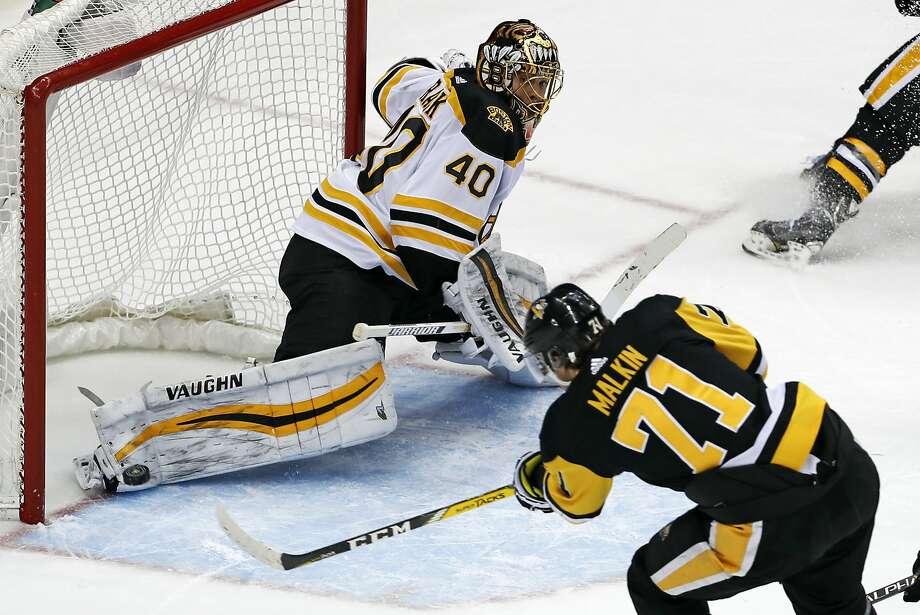 Pittsburgh's Evgeni Malkin puts the game-winning goal past Boston goaltender Tuukka Rask in overtime. Photo: Gene J. Puskar, Associated Press