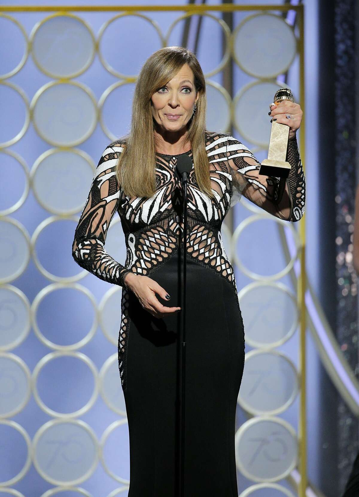"""This image released by NBC shows Allison Janney accepting the award for best supporting actress in a motion picture for her role in """"I, Tonya,"""" at the 75th Annual Golden Globe Awards in Beverly Hills, Calif., on Sunday, Jan. 7, 2018. (Paul Drinkwater/NBC via AP)"""