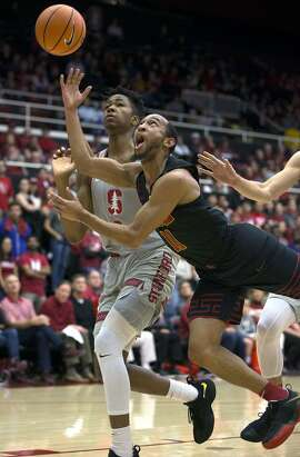 Southern California's Jordan McLaughlin (11) shoots in front of Stanford's Kenzie Okpala (0) during the first half of an NCAA college basketball game Sunday, Jan. 7, 2018, in Stanford, Calif. (AP Photo/D. Ross Cameron)