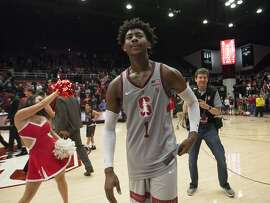 Stanford's Daejon Davis (1) walks off the court after his buzzer-beating 3-point basket gave his team the victory over Southern California in an NCAA college basketball game, Sunday, Jan. 7, 2018, in Stanford, Calif. Stanford won 77-76. (AP Photo/D. Ross Cameron)