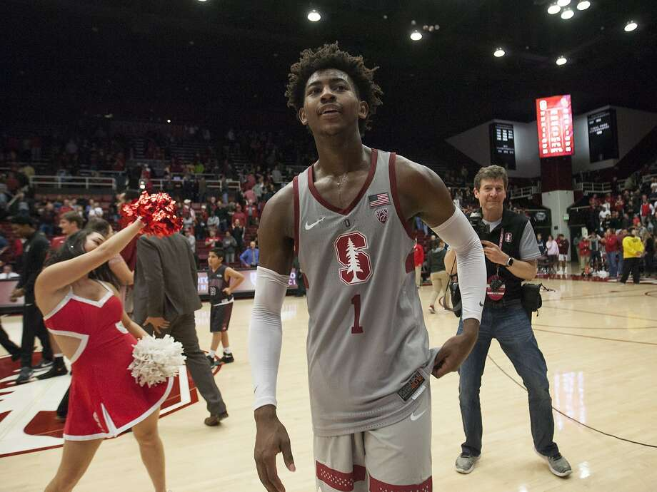 Stanford's Daejon Davis walks off the court after his buzzer-beating, half-court heave beat Southern Cal on Sunday. Photo: D. Ross Cameron, Associated Press