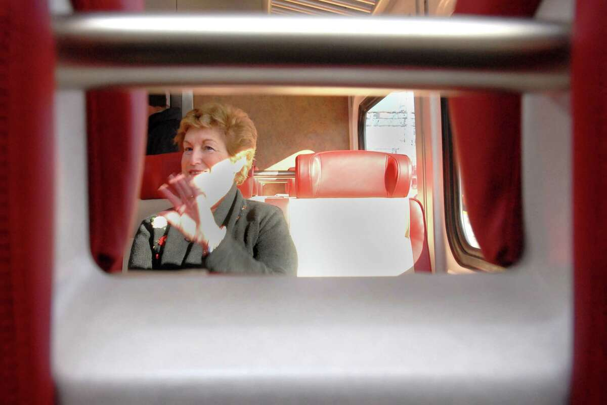 Brad Horrigan   New Haven Register. BH0491. New Haven, Connecticut - 12.24.09: Gov. M. Jodi Rell waves to someone while seated on a new M8 MetroNorth train at Union Station Thursday.