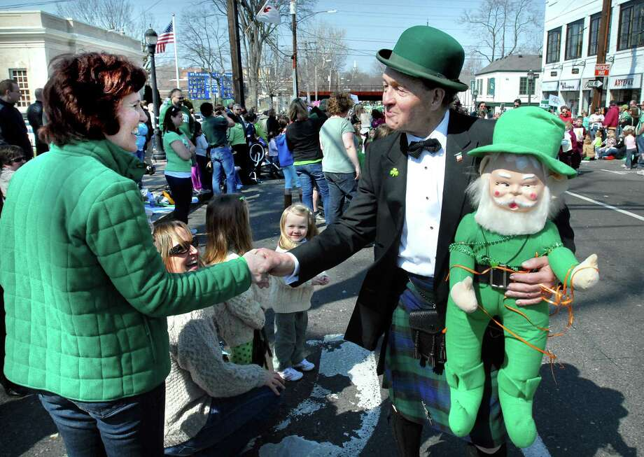 Noel Ryan (right) of New York works the crowd at the St. Patrick's Day Parade in Milford on 3/21/2010.