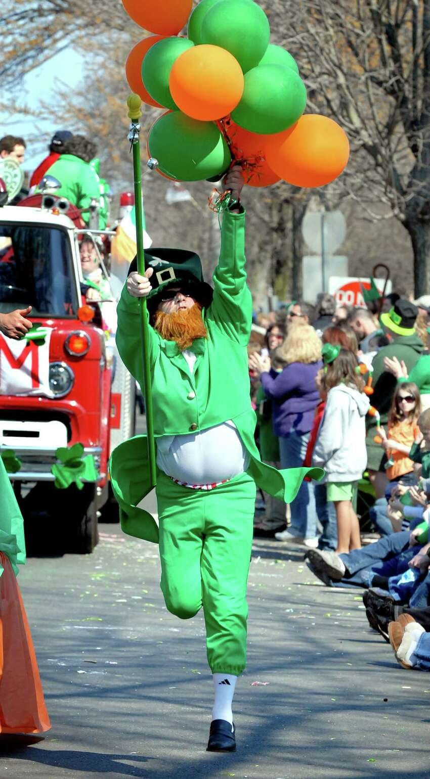 Ron Lombard of Milford appears to float into the air during the St. Patrick's Day Parade in Milford on 3/21/2010. Photo by Arnold Gold AG0356E