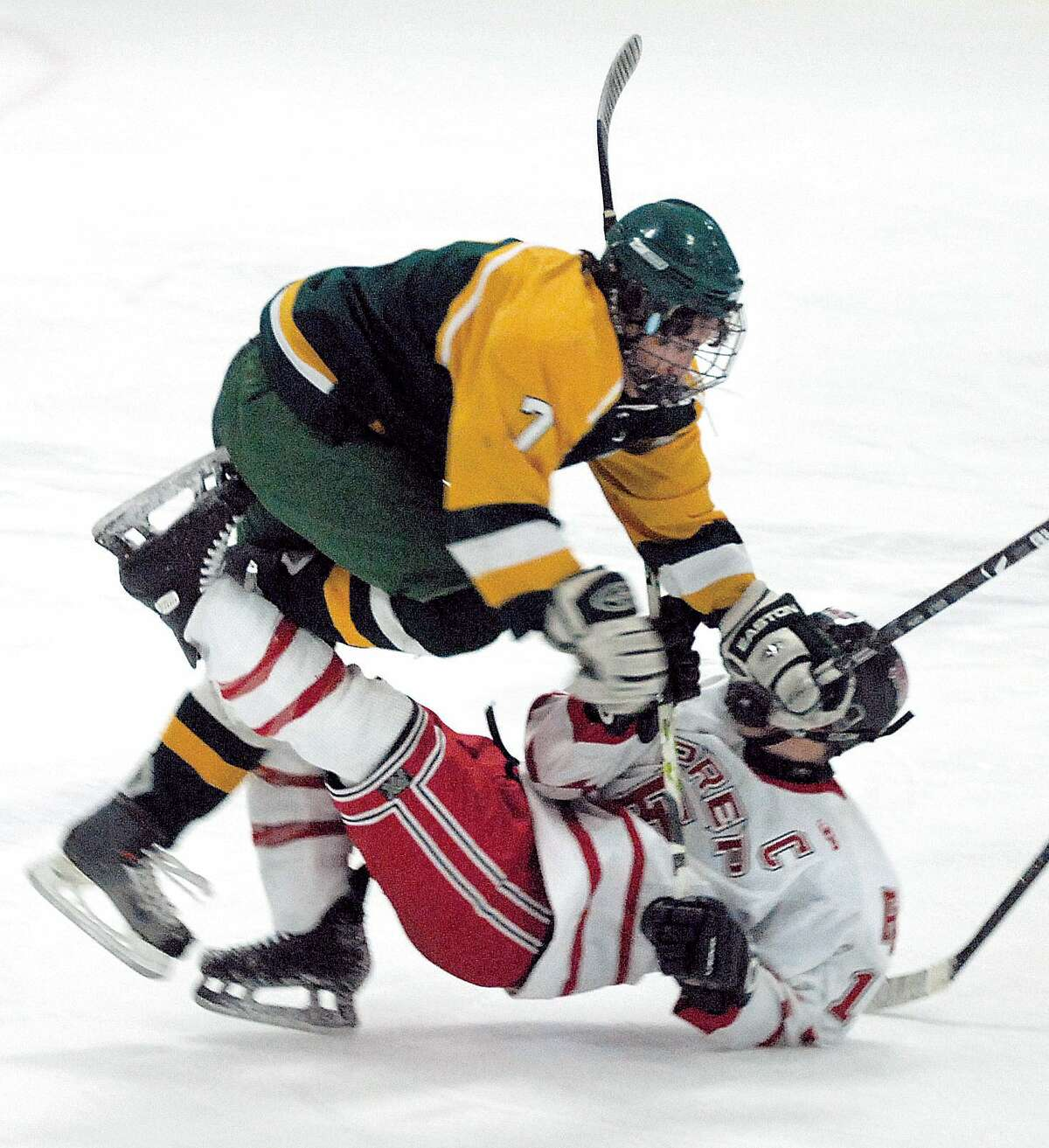 02/04/09 Cas090204 Photo-Peter Casolino Bridgeport-- Hamden's PJ Vakos takes out Fairfield Prep's Alex Zeiss with a clean check at center ice during the first period. Photo-Peter Casolino