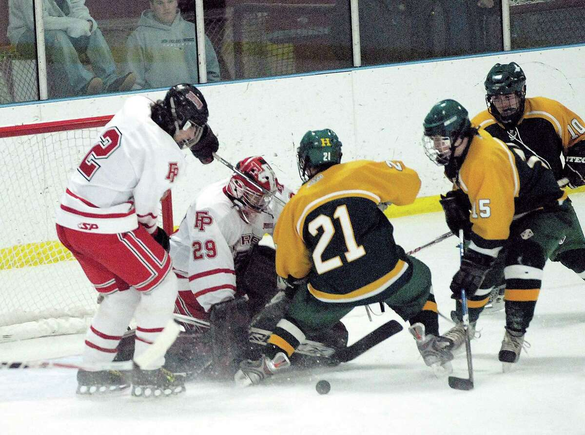 02/04/09 Cas090204 Photo-Peter Casolino Bridgeport-- Hamden's Michael Pierne (15) prepares to score as John Teulings (21) collides with Fairfield Prep Goalie Spencer Sodokoff during the second period. The goal put Hamden up 3-2. (On the left is FF Prep's (#2) Jackson Bargiello, and for Hamden on the extreme right; (#10) Scott Walsh. Photo-Peter Casolino