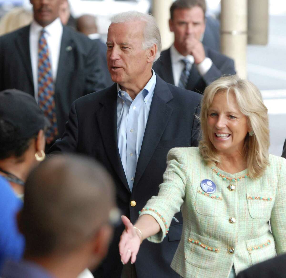 In this Aug. 25, 2008 file photo, Sen. Joe Biden,D-Del., left, and his wife Jill Biden, right, made a surprise appearance at the Amtrak train station in Wilmington, Del., he has used for years to commute to his day job in the U.S. Senate.