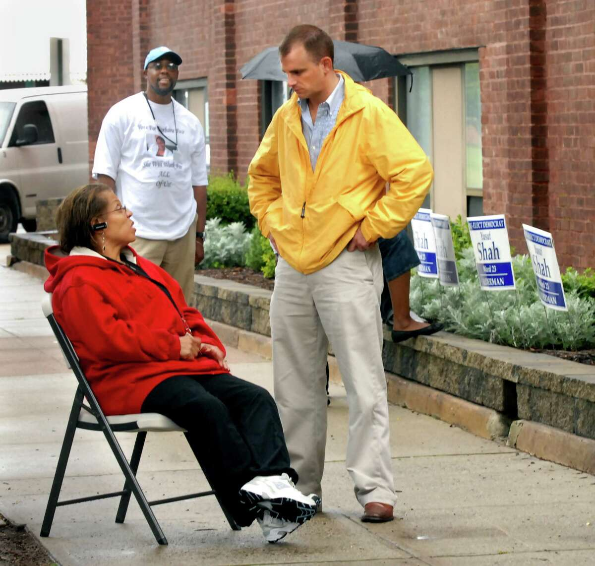 (ms091107)PRIMARY-Jacqueline Harris, Co-chair of ward 23, and Alderman Alex Rhodeen chat in front of the Berger Apartments, where primary voting is taking place. In the background, wearing a tee shirt supporting Barbara Fair, is James Hanton. Melanie Stengel/Register
