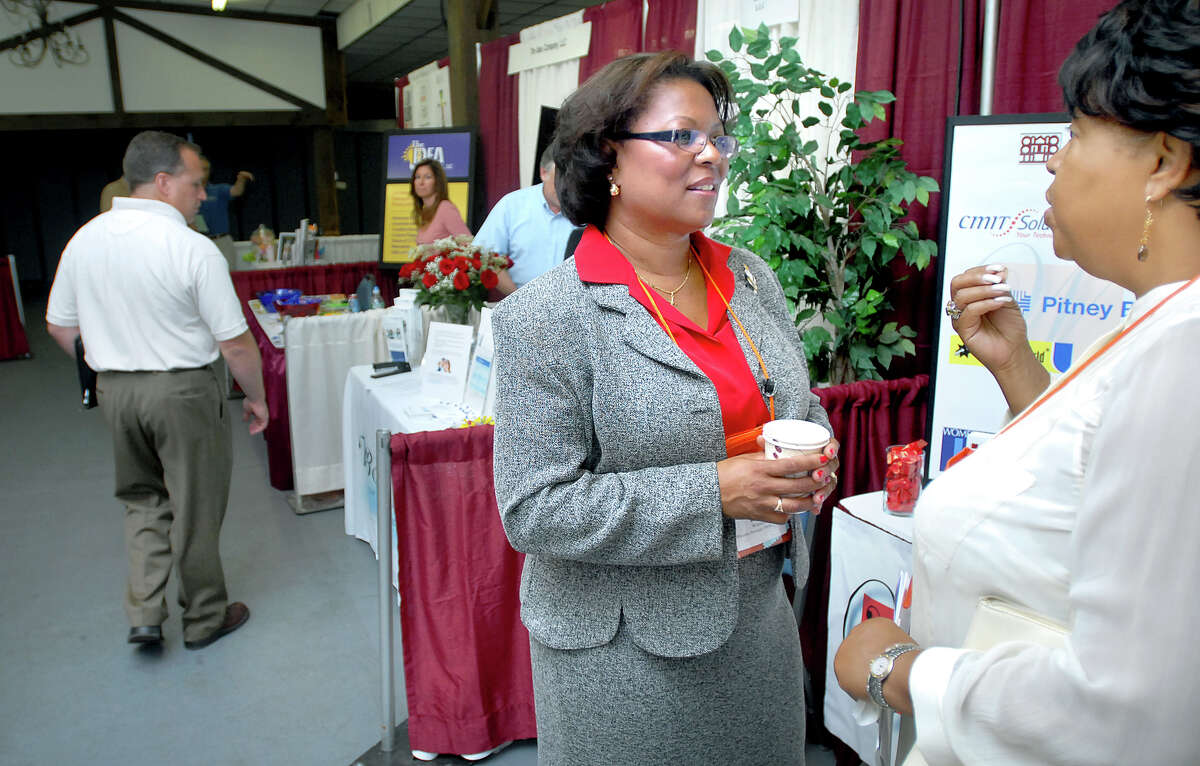 biz-business fair-ag-9/11/08 Diane Winston (center), principal of Winston Strategic Partners, speaks with Terri Smith (right) of the National Kidney Foundation of Connecticut at the Connecticut Small and Minority Business Showcase in Wallingford on 9/11/2008. Photo by Arnold Gold AG0276A