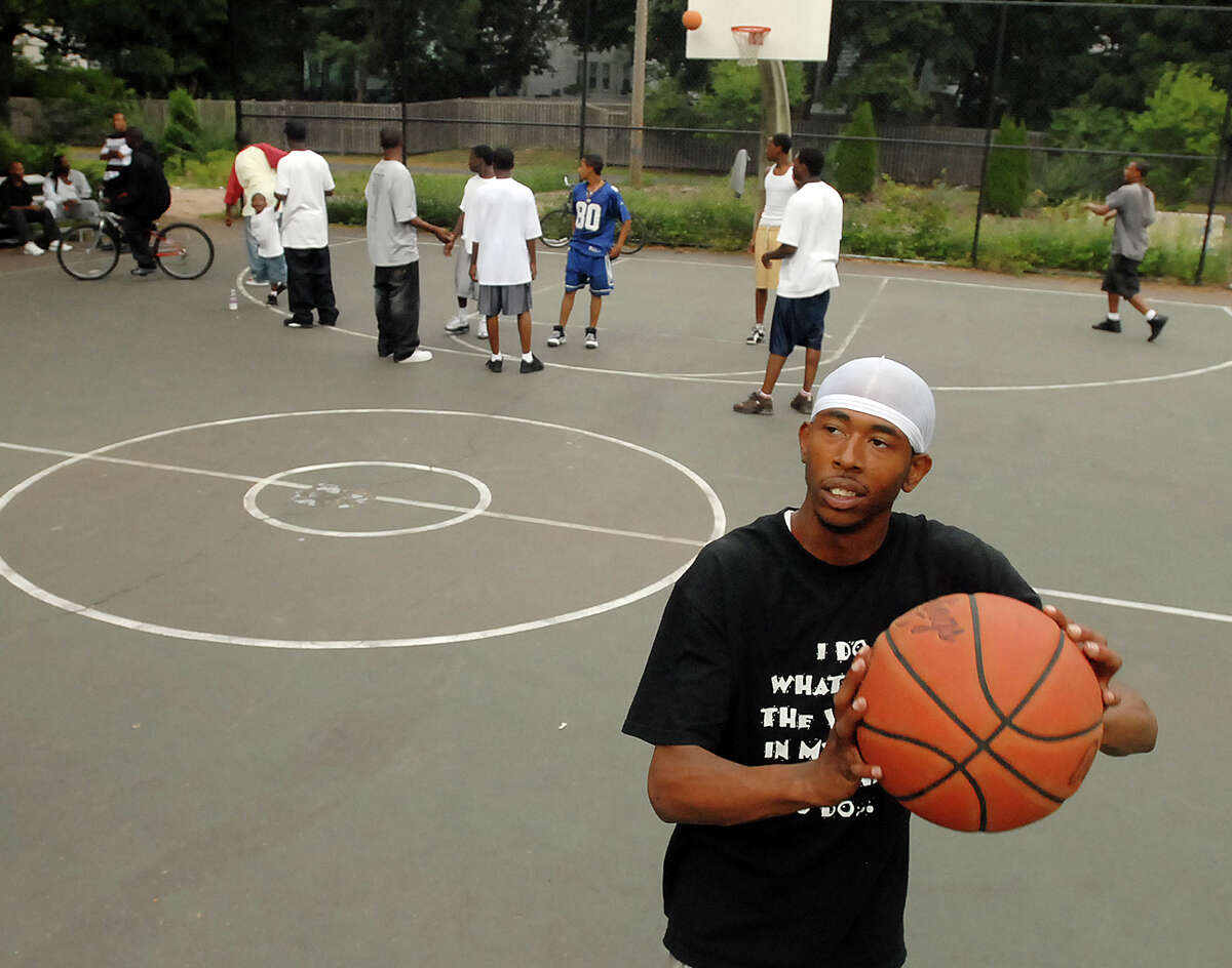 NEW HAVEN-GANGS MAKE PEACE-PHOTO/JEFF HOLT-JH00192T 9/14/07-19 year old Ricky Reid, Jr. is a member of the Dixwell Ave. neighborhood gang known as the Tribe. He warmed up before a game with the Newhallville neighborhood gang known as the Tribe. (Photo/Jeff Holt)