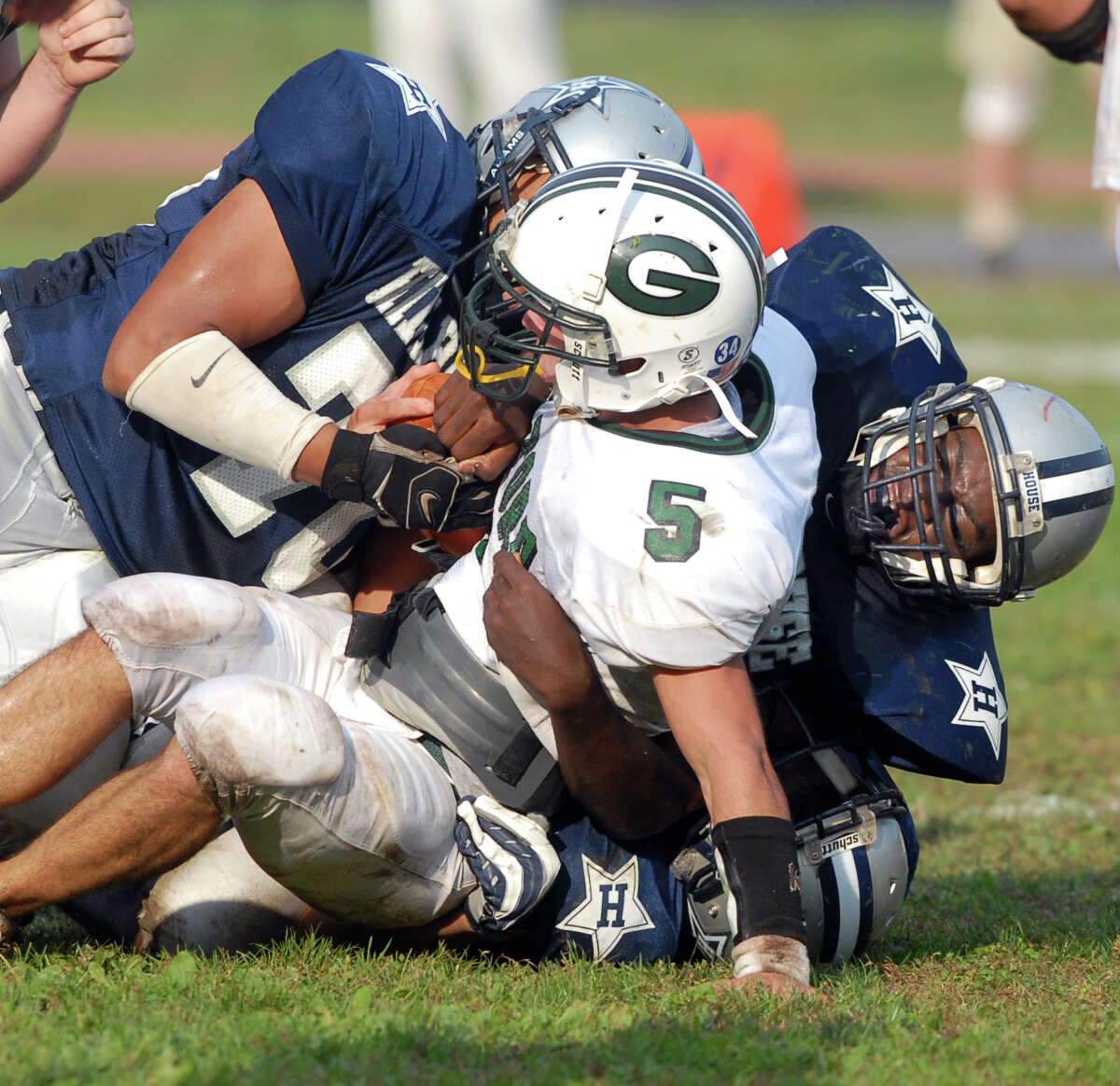 NE10/5/07 2HHGuil ML0397E Bowen Field, New Haven: Hillhouse's Tavon Wilkins left and Reno Dunkley right stopping Guilford's Fred Turcio. Photo by Mara Lavitt