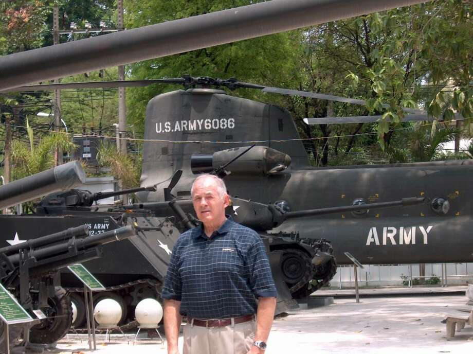 Westporter Robert Stokes stands in front of a captured U.S. helicopter outside the War Remnants Museum in Ho Chi Minh City, Vietnam. Stokes covered the war as a journalist, and returned to Vietnam recently for the first time since the war. Photo: Contributed Photo / Westport News