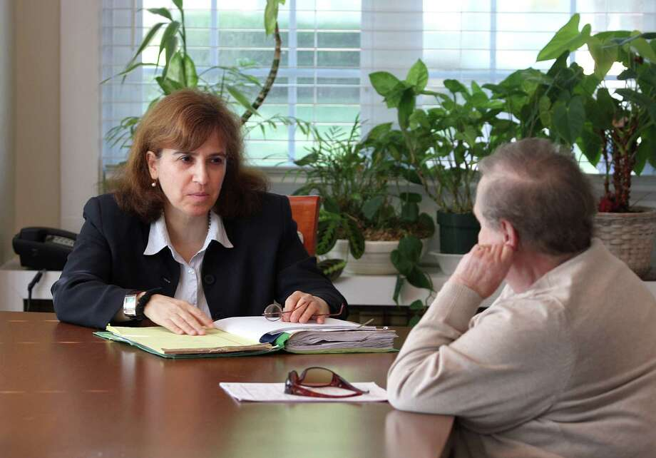 Attorney Patricia Cofrancesco works with a client in her East Haven office. Photo-Peter Casolino