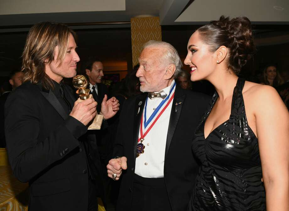 FILE - (L-R) Singer Keith Urban, astronaut Buzz Aldrin and guest attend HBO's Official Golden Globe Awards After Party at Circa 55 Restaurant on Jan. 7, 2018 in Los Angeles, Calif. Aldrin, a former astronaut, is endorsing Republican contender Dan Crenshaw to replace Rep. Ted Poe, R-Texas. Photo: Emma McIntyre/Getty Images