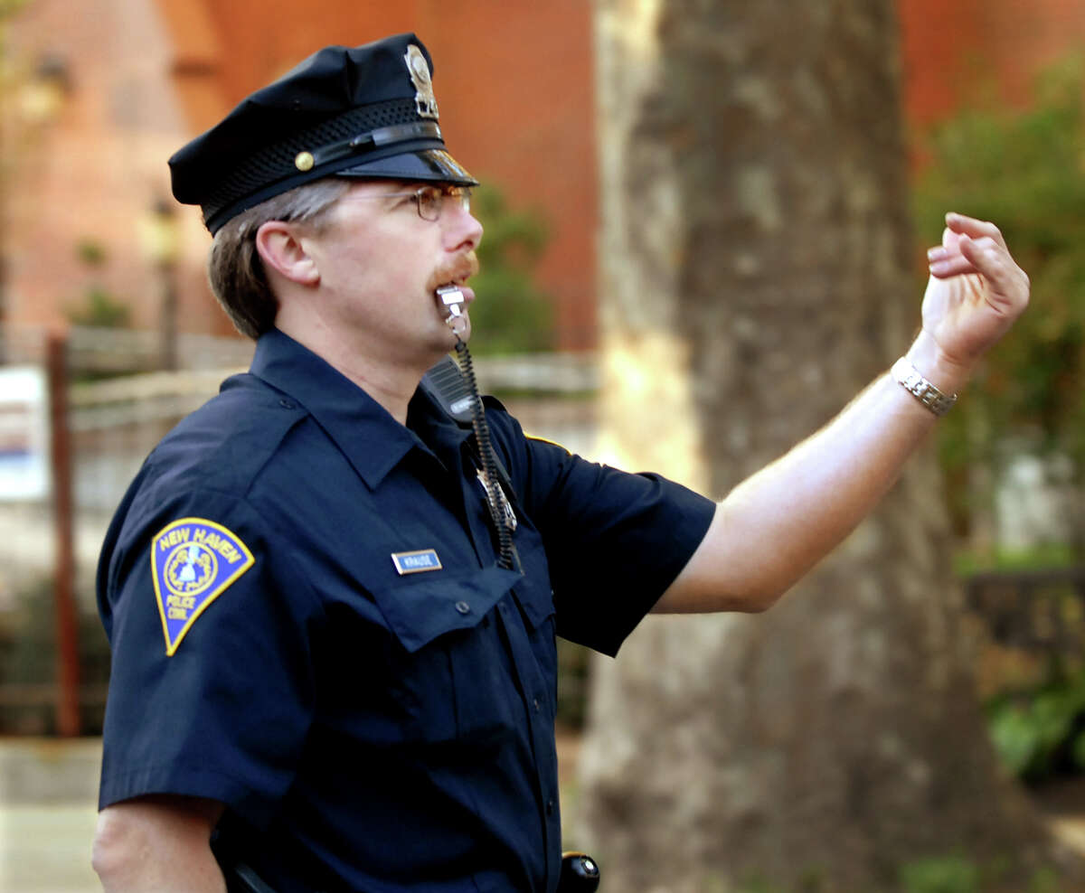 (MS092107)-New Haven police officer, Peter Krause, pulls over a driver who had run the stop sign at the corner of Wooster place and Green Street. Melanie Stengel/Register