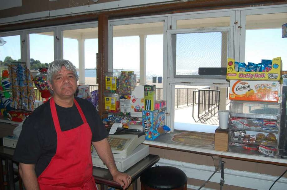 Rory Romero preps for the Fourth of July crowds at Ocean View, the Jennings Beach concession stand. Photo: Tim Loh / Fairfield Citizen