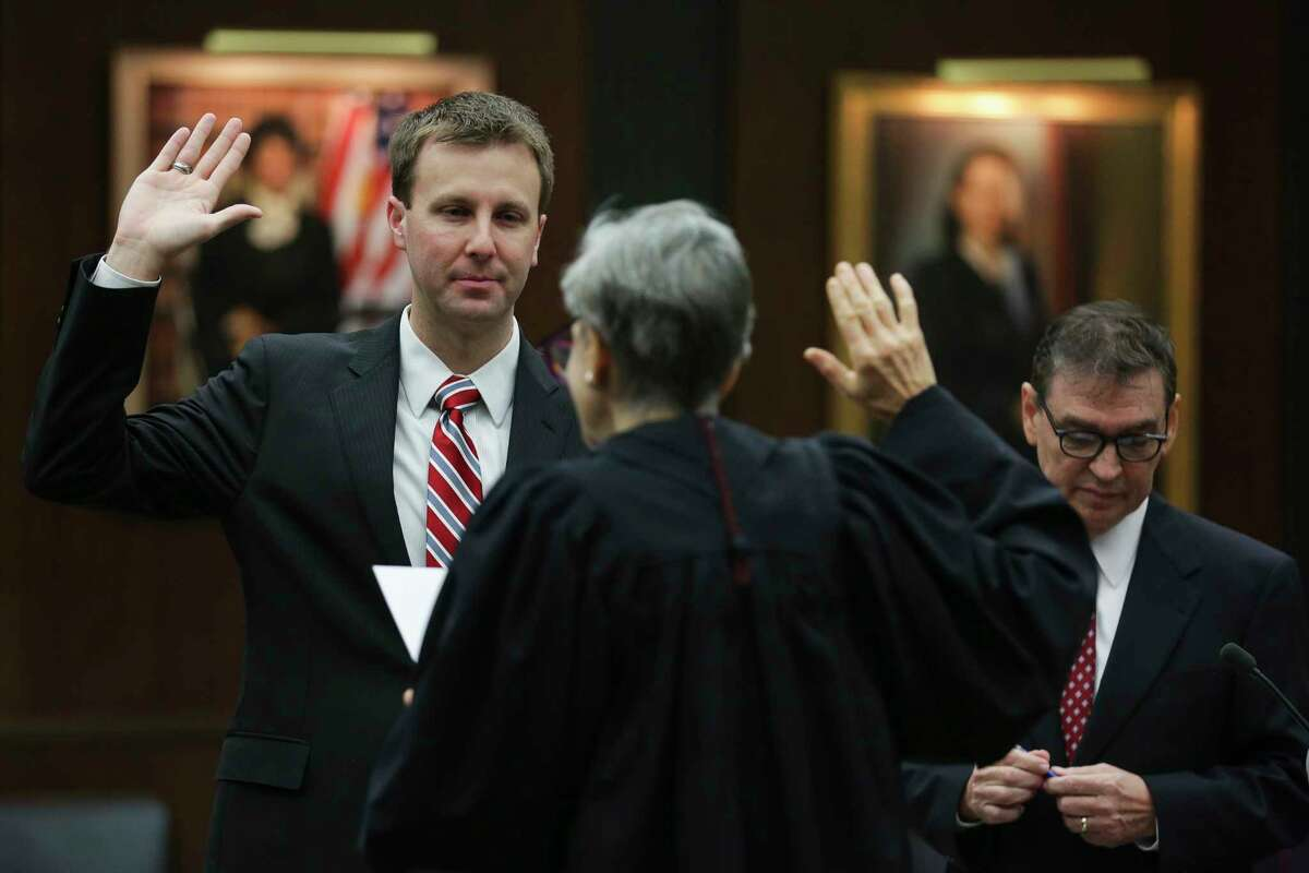 Former state district judge Ryan Patrick, left, the newly appointed U.S. Attorney for the Southern District of Texas, is administered his oath of office by Chief U.S. District Judge Lee H. Rosenthal, center, at the federal courthouse Monday, Jan. 8, 2018 in Houston.