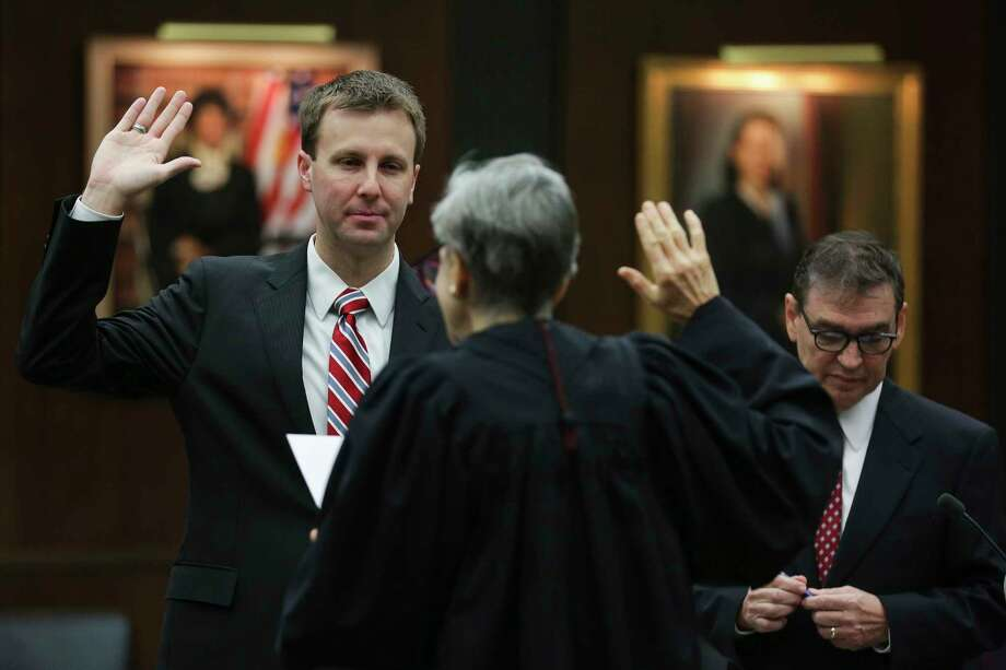 Former state district judge Ryan Patrick, left, the newly appointed U.S. Attorney for the Southern District of Texas, is administered his oath of office by Chief U.S. District Judge Lee H. Rosenthal, center, at the federal courthouse Monday, Jan. 8, 2018 in Houston. Photo: Michael Ciaglo, Houston Chronicle / Michael Ciaglo