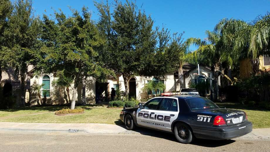 A Laredo police unit is shown outside a home in the 3000 block of Robert Frost on Friday afternoon. Authorities said they executed a search warrant at the home in connection with an illegal gambling investigation. The property is owned by Joel Lopez, head coach of the Alexander High School football team. Photo: Cesar Rodriguez/Laredo Morning Times