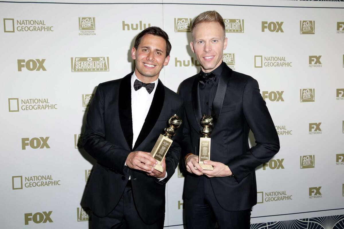 BEVERLY HILLS, CA - JANUARY 07: Songwriters Benj Pasek (L) and Justin Paul, winners of Best Original Song for 'This Is Me' from 'The Greatest Showman,' attend Hulu's 2018 Golden Globes After Party at The Beverly Hilton Hotel on January 7, 2018 in Beverly Hills, California. (Photo by Rachel Murray/Getty Images for Hulu)