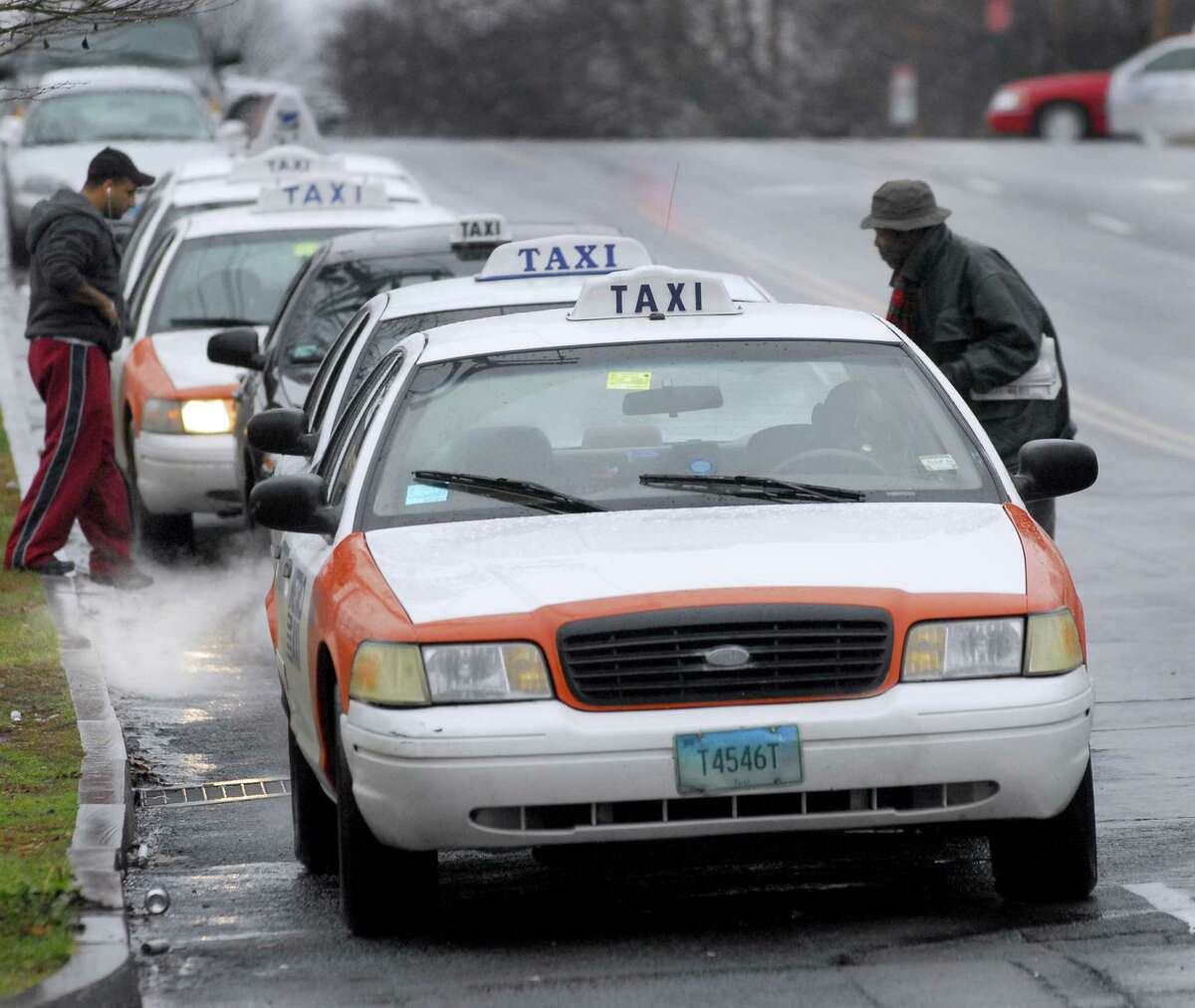 Photography by PETER HVIZDAK ph972 #2559 New Haven, Connecticut- 12/17/08: Taxi's line up outside of Union Station at the Taxi Stand on Union Ave. in New Haven.