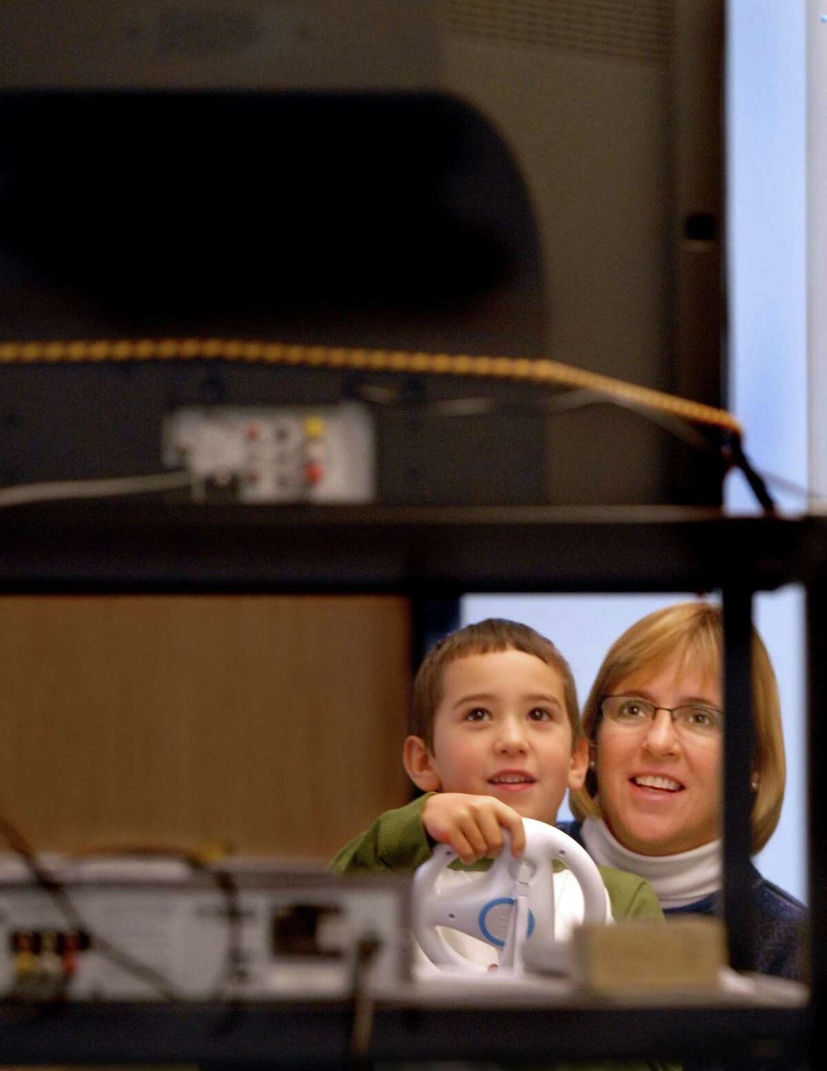 (ms121208)-occupational therapist, Joan Kirsch,and Zachery Martin, a 1st grader at A.W.Cox Elementary School in Guilford, play a Mario Brothers racing game on a Nintendo Wii. Martin hopes the games will improve Martin's handwriting skills. Melanie Stengel/Register