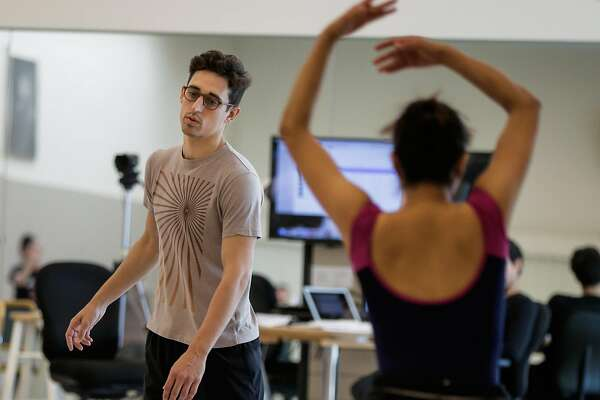 Choreographer Justin Peck (left) watches his dancers during a rehearsal at the San Francisco Ballet in San Francisco, Calif., on Friday, Aug. 18, 2017.