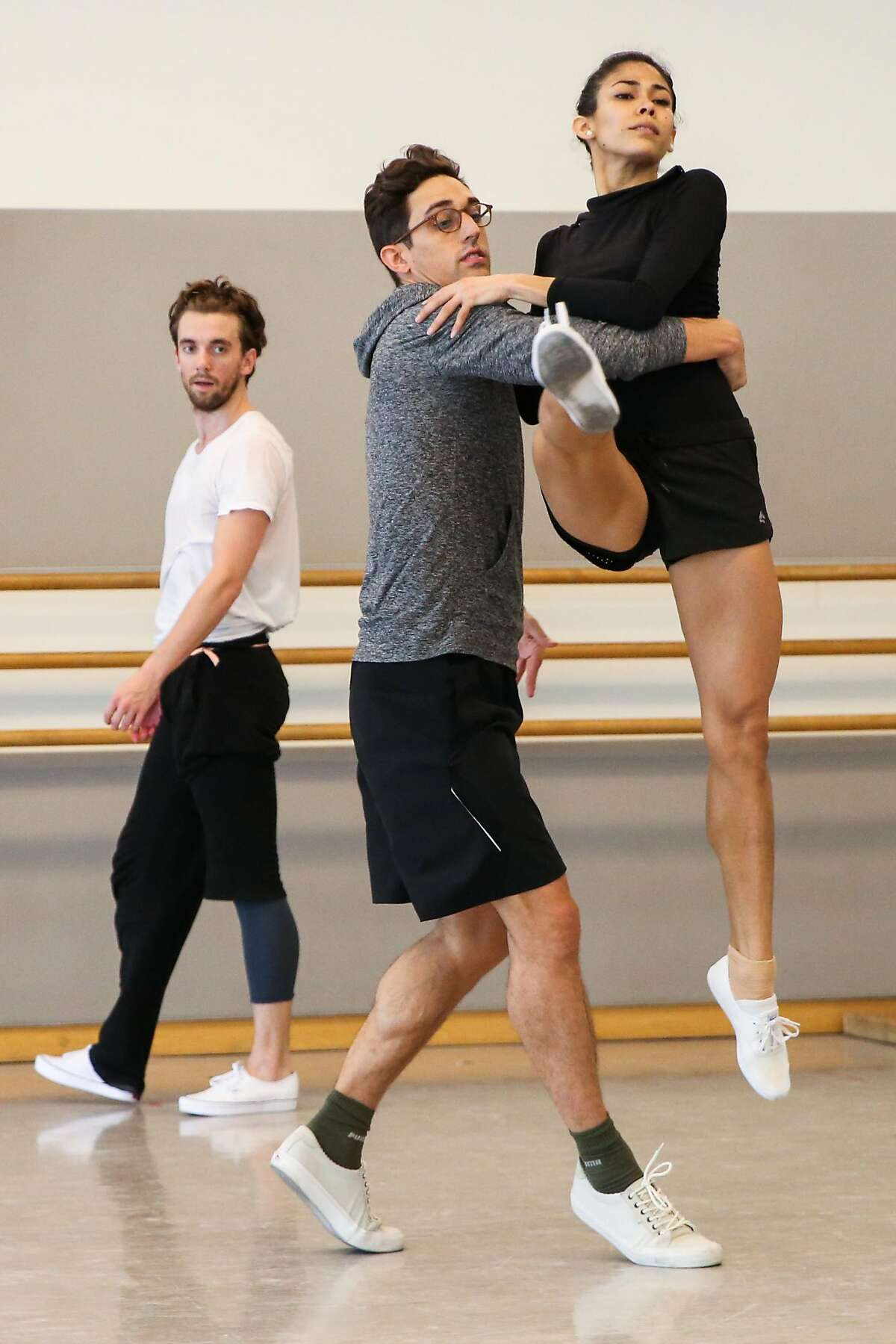 Choreographer Justin Peck (center) guides dancer Gabriela Gonzalez (right) during rehearsals at the San Francisco Ballet in San Francisco, Calif., on Wednesday, Aug. 16, 2017.