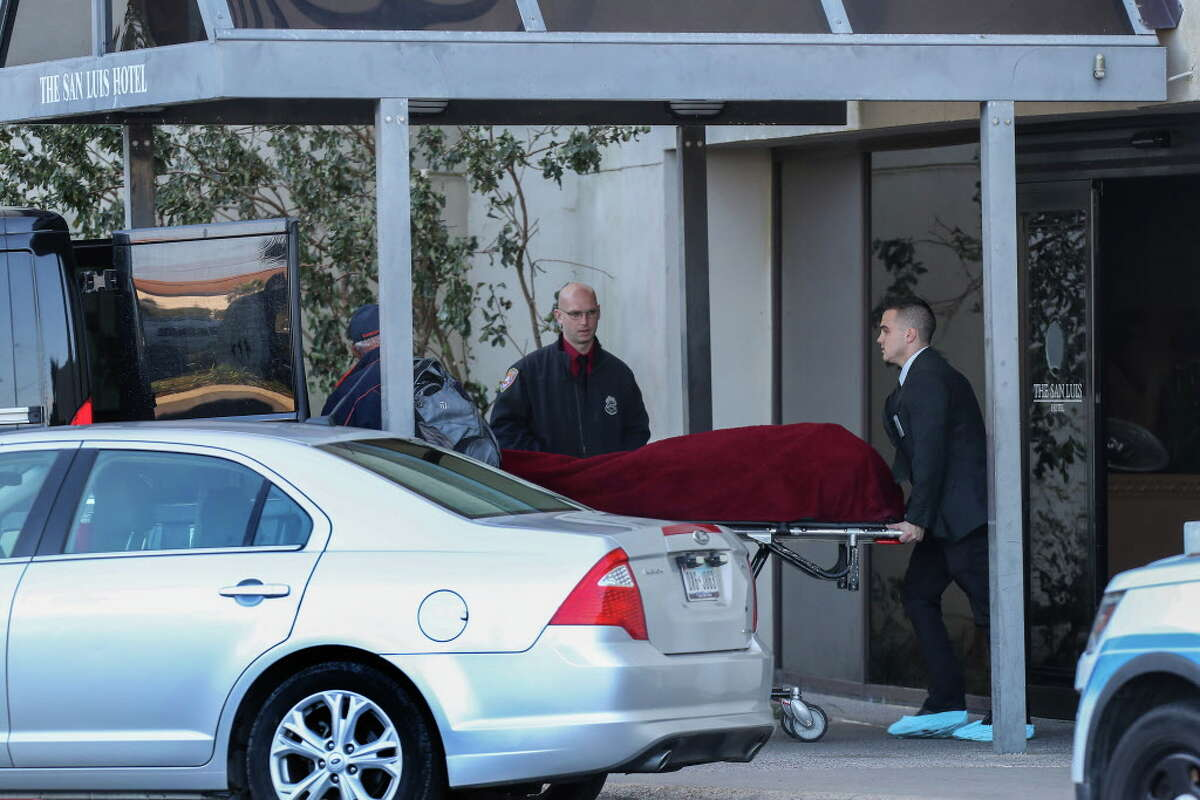 """Officials remove one of three dead persons from the San Luis Resort Monday, Jan. 8, 2018, in Galveston. Three people are dead and another is critically wounded after what police are describing as an apparent murder-suicide at a Galveston resort hotel. Galveston police responded to a 911 call around 4:30 a.m. Monday after a hotel guest at the San Luis Resort reported hearing """"pops"""" coming from a nearby room, said Galveston Police Department spokesman Joshua Schirard."""
