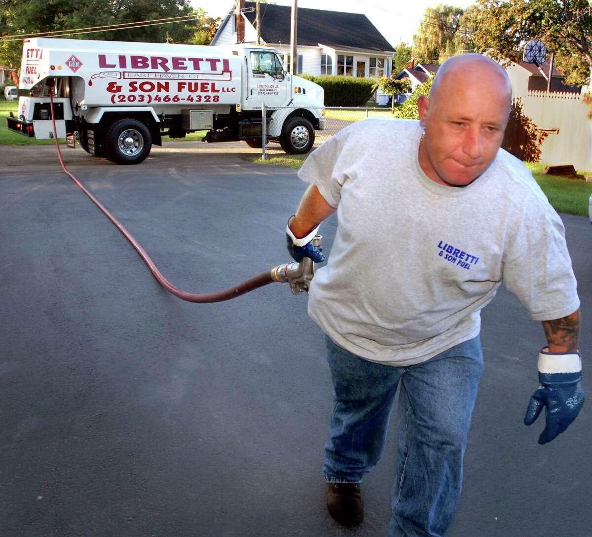 (ms093009)-Nick Libretti, owner of Libretti & Son Fuel delivers oil in East Haven. Melanie Stengel/Register