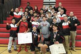 Izaake Zuckerman (162), kneeling left, and Joe Gjinaj (197), kneeling right, won their respective weight classes in the 2018 Warde wrestling Invitational on January 6. The Mustangs won the team competition with a total of 189 points.