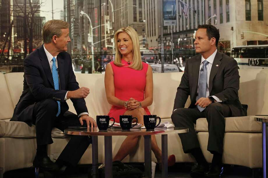 """The cast of """"Fox & Friends,"""" including Steve Doocy, left, Ainsley Earhardt, center, and Brian Kilmeade, right, are animated in a new Stephen Colbert cartoon series about President Trump and his administration. (Carolyn Cole/Los Angeles Times/TNS) Photo: Carolyn Cole /TNS / Los Angeles Times"""