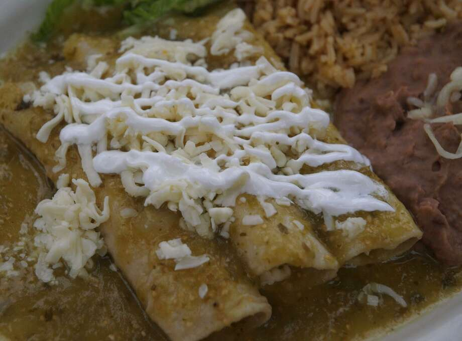 Enchiladas Verdes were a popular menu item at Picante Grill, which recently closed after almost 20 years of business. Photo: Express-News File Photo / Robert McLeroy