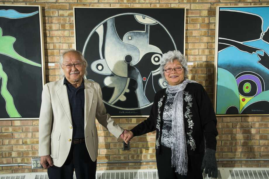 """Local artist Robert Iwamasa poses for a portrait with his wife, Ruby Iwamasa, January 5, 2018 inside Robert's painting exhibit, called """"A Wonderful Line,"""" at Creative 360 in Midland. (Katy Kildee/kkildee@mdn.net) Photo: (Katy Kildee/kkildee@mdn.net)"""