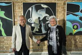"""Local artist Robert Iwamasa poses for a portrait with his wife, Ruby Iwamasa, inside Robert's new exhibit, called ?'A Wonderful Line,?"""" currently on display at Creative 360 in Midland. (Katy Kildee/kkildee@mdn.net)"""