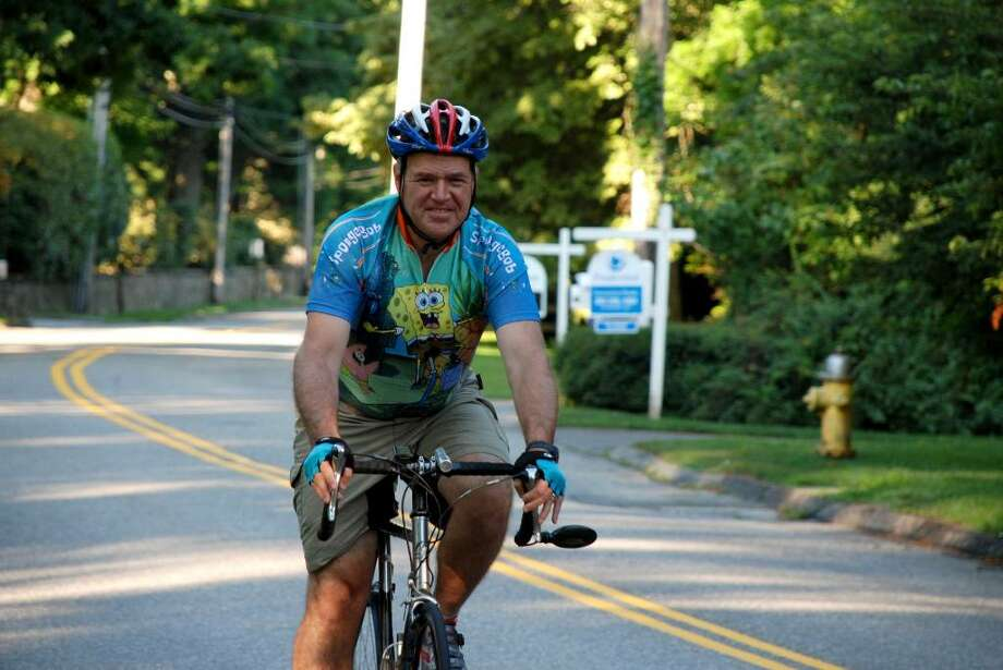 Doug Fried en route from his home in Southport to his office in Stamford. Photo: Contributed Photo, Lori Hashizume / Fairfield Citizen