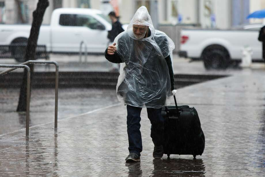 A steady rainfall made for slick conditions in downtown Oakland on Monday January 8, 2018. A storm that may end up being the wettest of the season made landfall in  the Bay Area early Monday, causing havoc on Bay Area freeways as  multiple crashes were reported, as well as flooding and hydroplaning  vehicles. Photo: Douglas Zimmerman / SFGate