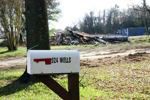 The post box shows the address of a home that no longer exists. It was razed to the ground by the city after it was abandoned because of severe damage from Hurricane Harvey.