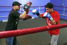 Photography by PETER HVIZDAK   ph1980   #4067 New Haven, Connecticut - June 17, 2009: Boxer Luis Rosa Jr., right, sparring with his father and trainer Luis Rosa at the Boxing in Faith Gym on Grand Ave. in New Haven. Rosa, 18, of New Haven, has been selected to train with the U.S. National Boxing Team.
