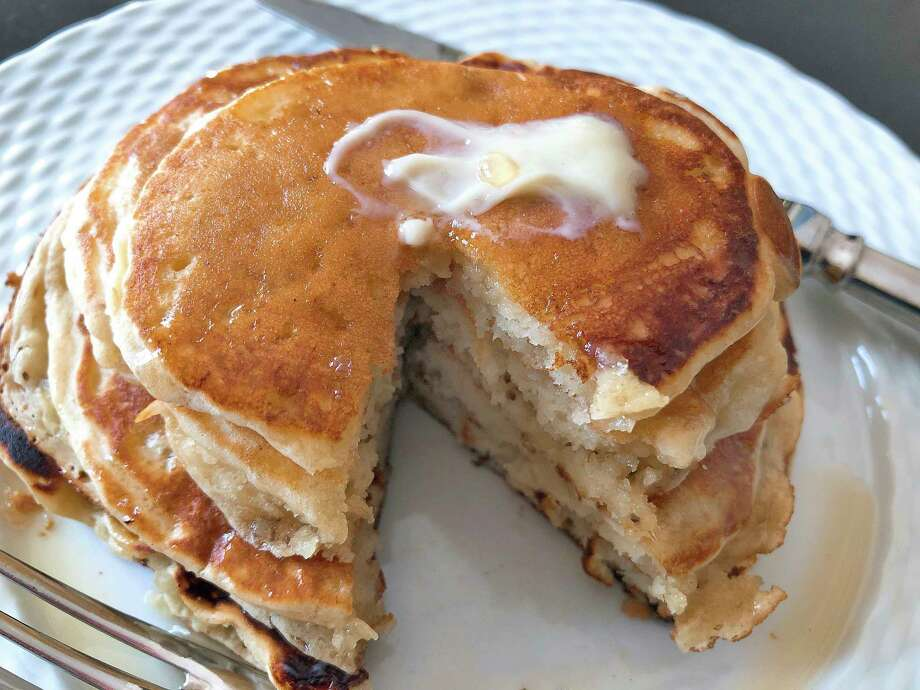 This undated photo shows ripe banana pancakes. The bananas are mashed as if making banana bread and added to the batter right before the pancakes are prepared. The result is almost like banana bread pancakes. (AP Photo/Elizabeth Karmel) Photo: Elizabeth Karmel, UGC / Copyright 2017 The Associated Press. All rights reserved.