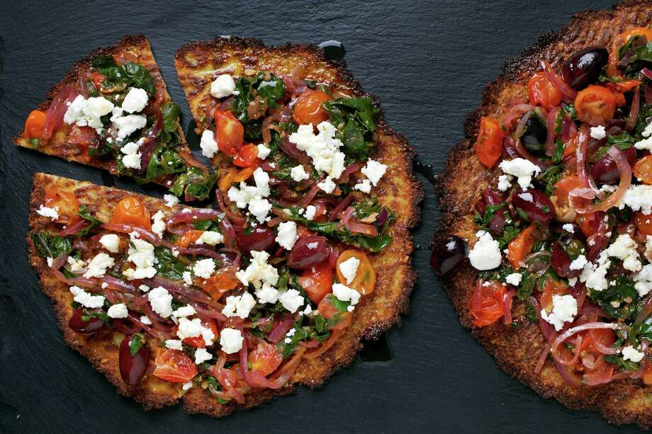 Cauliflower Pizzas With Chard and Olives Photo: Deb Lindsey / For The Washington Post