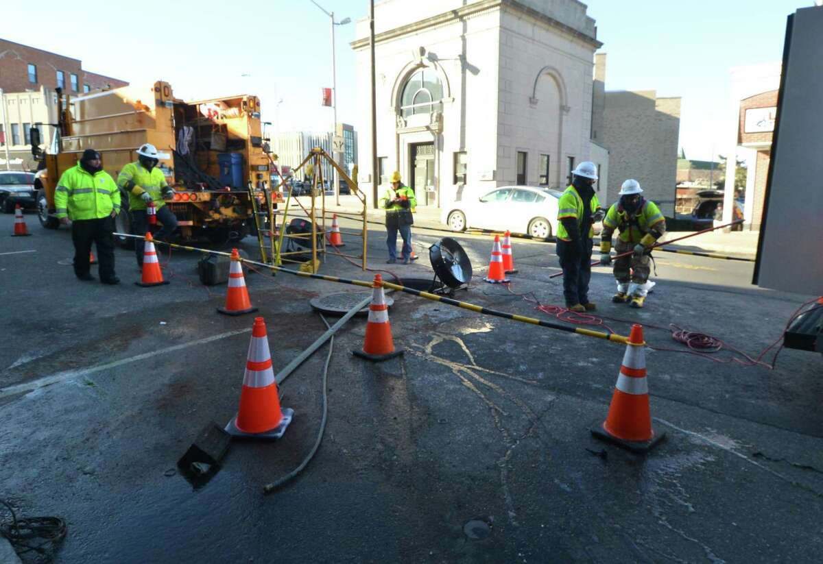 An Eversource crew working in downtown Norwalk, Conn., on Dec. 27, 2017. Eversource confirmed on Jan. 8 it plans to work with state regulators to funnel to ratepayers and unspecified percentage of its savings under the federal Tax Cuts and Jobs Act.