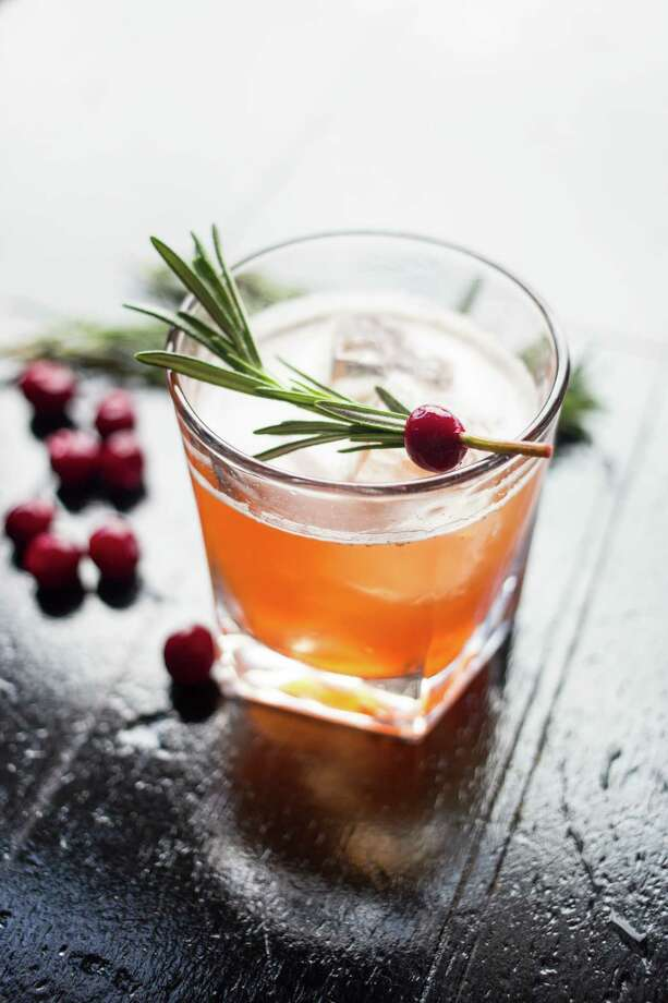The Red Headed Stranger (scotch, mandarin liqueur, cranberry juice and rosemary simple syrup) Photo: Becca Wright
