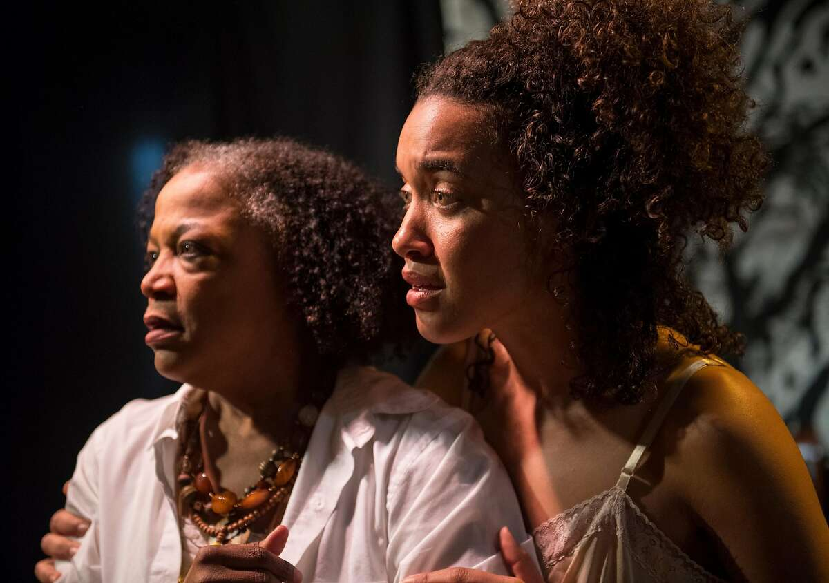 """Zuri (Dezi Sol�y, right) urges Azucar (Cathleen Riddley) to give up her place of rest�and create a different future in AlterTheater's """"Bondage."""""""