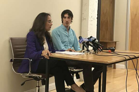 James Damore (right), a Google engineer fired for a controversial memo about diversity, sits at a press conference in downtown San Francisco with his lawyer, Harmeet Dhillon of the Dhillon Law Group.