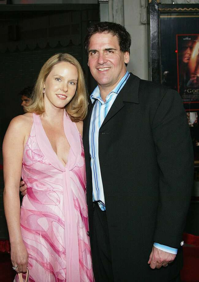 "Dallas Maverick's owner Mark Cuban and wife Tiffany attend  the world premiere of film ""Godsend"" on April 22, 2004 in Hollywood, California. Photo: Frederick M. Brown/Getty Images"