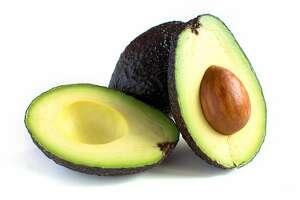 A fresh avocado cut in half Fotolia
