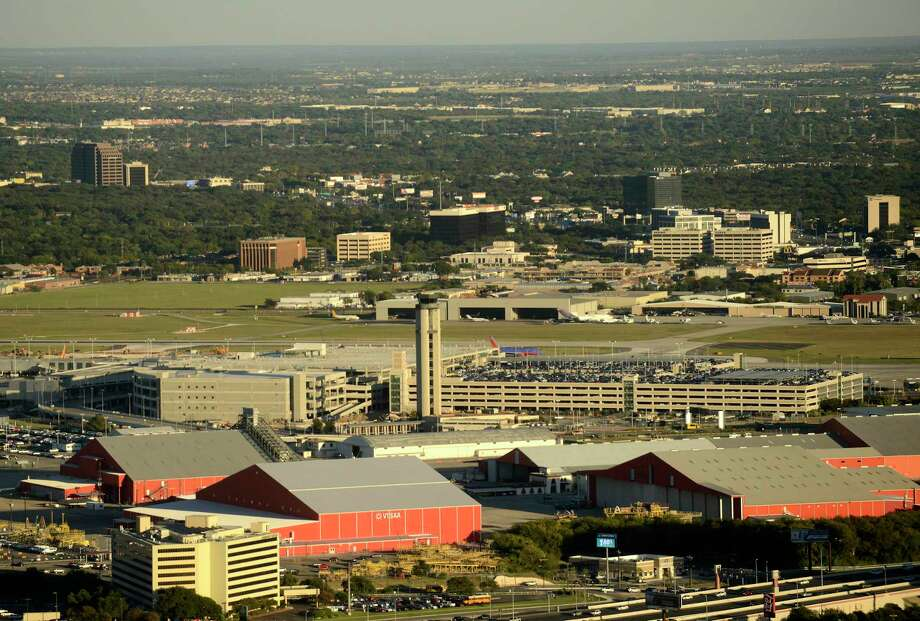 San Antonio officials are weighing whether to build a new runway and terminal at San Antonio International Airport — moves that could require the city to purchase nearby land. Photo: Express-News File Photo